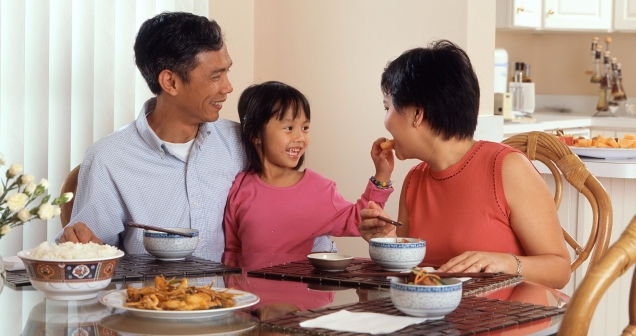 family eating in table